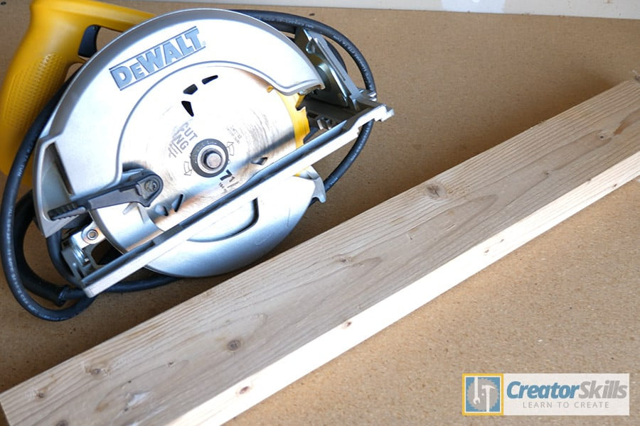 Circular saw and 2x4 on woodshop work bench large