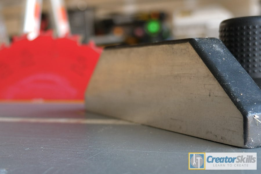 Table saw miter gauge on angle with red blade in background large